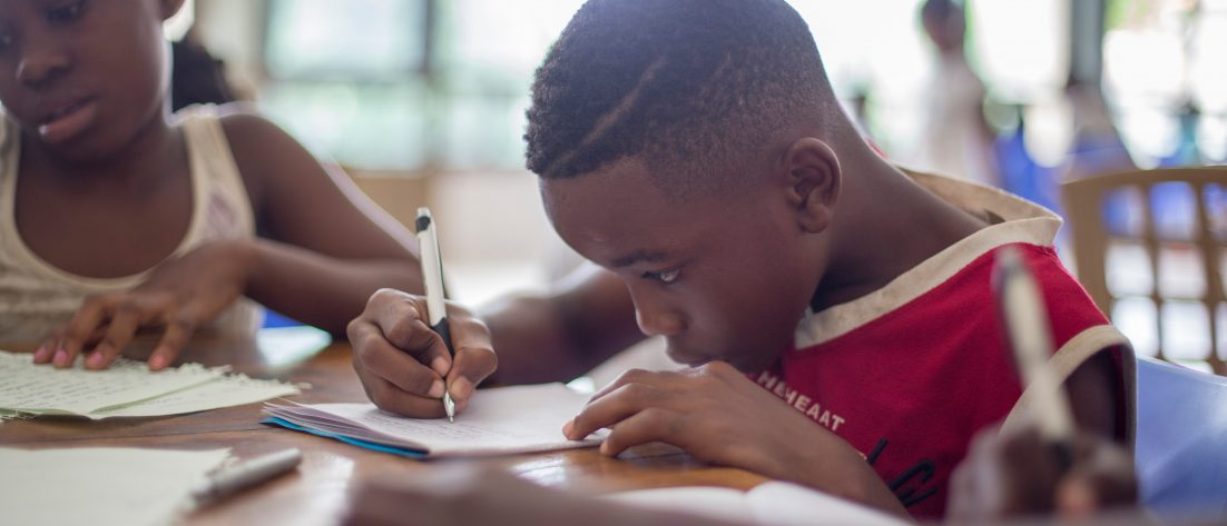 Black childrens studying in classroom