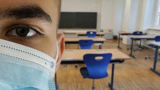 Student wearing mask in a classroom