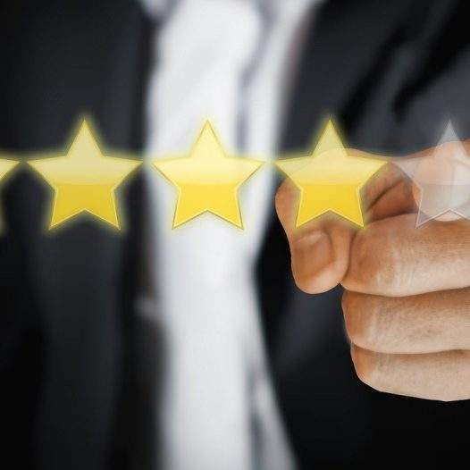 person selecting evaluation stars